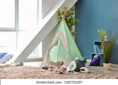 Cozy play tent for kids in interior of room