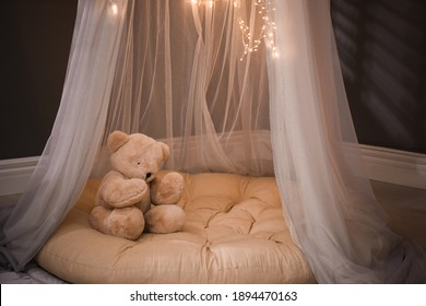 Cozy play tent with teddy bear indoors
