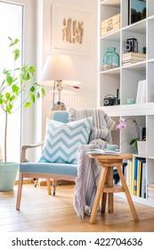 Cozy reading corner with armchair.