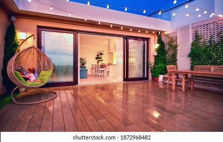 cozy rooftop patio with sliding doors in the evening after the rain