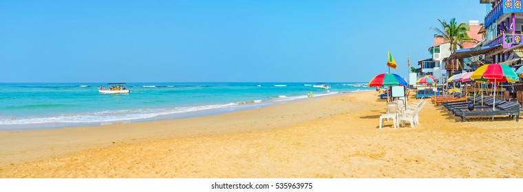 The cozy sand beach of Hikkaduwa is the best place to relax, drink some fresh local coctail and go to swim in Indian Ocean, Sri Lanka.