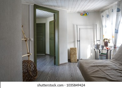 cozy small multifunctional room interior in Scandinavian style, natural light and minimalistic design, coffee table with mug and tea spot, natural decor, wooden green door