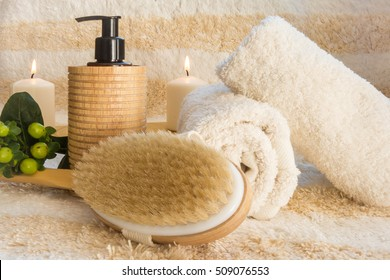 Cozy SPA setting ready for spa treatment or relaxation massage with the natural brush and massage oil / SPA background