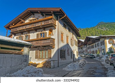 Cozy street in Bavarian Village Garmisch-Partenkirchen (Germany), on a sunny winter day. It is a tourist and winter sports centre and has some of Germany's best skiing areas