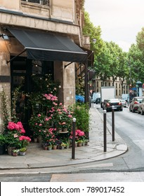 Cozy street with flower shop in Paris, France. Architecture and landmarks of Paris. Postcard of Paris