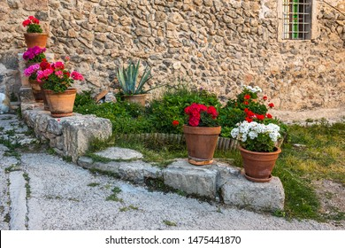 A cozy street  with flowers in the old town of Valdemossa