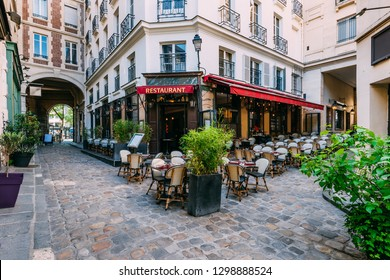Cozy street near Boulevard San-German with tables of cafe  in Paris, France. Architecture and landmark of Paris. Paris cityscape