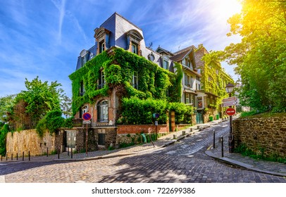 Cozy street of old Montmartre in Paris, France. Cozy cityscape of Paris. Architecture and landmarks of Paris.