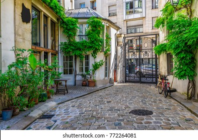 Cozy street in Paris, France. Architecture and landmarks of Paris. Postcard of Paris