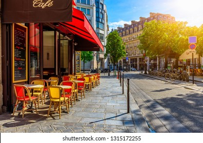 Cozy street with tables of cafe in Paris, France. Cityscape of Paris. Architecture and landmarks of Paris.