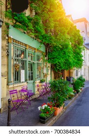 Cozy street with tables of cafe in Paris, France. Architecture and landmark of Paris. Cozy Paris cityscape