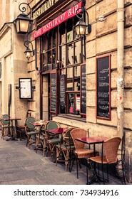 Cozy street with tables of cafe in Paris, France. Architecture and landmarks of Paris. Postcard of Paris