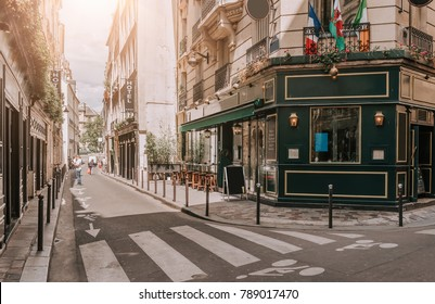 Cozy street with tables of irish pub in Paris, France. Architecture and landmarks of Paris. Postcard of Paris