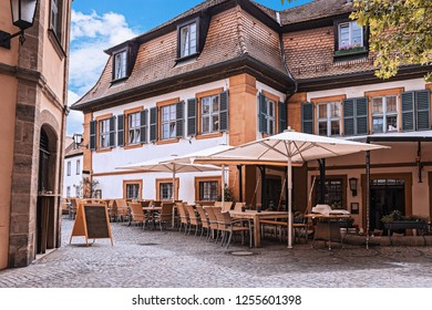 Cozy street with tables of restaurants in Bamberg, Germany