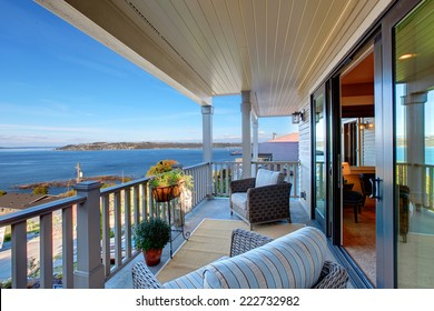 Cozy walkout deck with chairs with scenic view on Puget Sound, Tacoma, WA