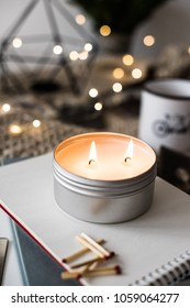 Cozy warm home decoration with burning candle and bokeh lights