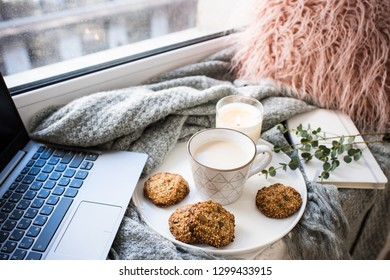 Cozy weekend breakfast with cup of coffee and cookies on ceramic tray