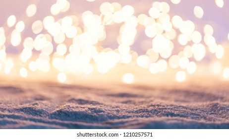 Cozy winter background with snow and fairy lights. Bokeh. Christmas backdrop.