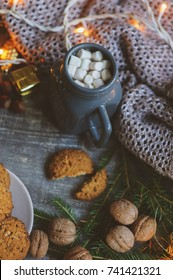 Cozy winter and Christmas setting with hot cocoa with marshmallows and homemade cookies. Warm and homely, Danish hygge concept