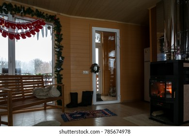 cozy winter cottage interior. furnished wooden cottage interior with decoration