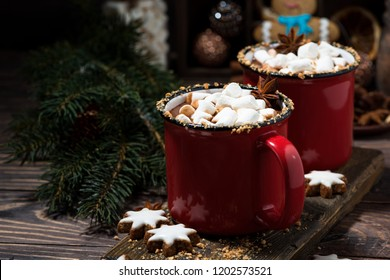 cozy winter drink hot chocolate in red mugs, closeup horizontal