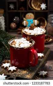 cozy winter drink hot chocolate in red mugs, vertical closeup