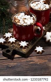 cozy winter drink hot chocolate on a wooden table, top view