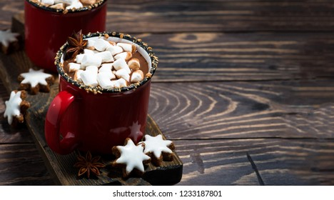 cozy winter drink hot chocolate with marshmallows on wooden table, top view