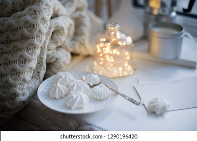 Cozy winter interior styling and decor, warm string lights in bell jar