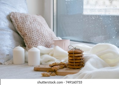 cozy winter still life: warm woolen knitting, hot tea, red book, Christmas cookies and music. Headphones. Hygge style. Cozy winter home morning holiday. Soft photo