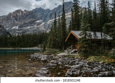 Cozy wooden cabin on shore of Lake Ohara in Yoho National Park, Canadian Rockies. Tourist/hikers summer accommodation in the mountains. Beautiful British Columbia, Canada