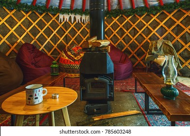 cozy yurt camping interior with fireplace inside. Authentic glamping territory.