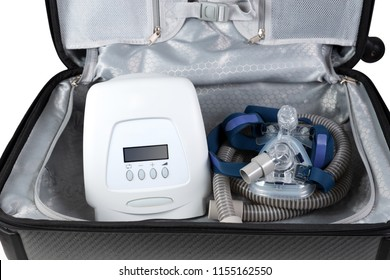 CPAP machine laying in traveling bag ready for a trip,white background.CPAP portable .