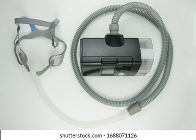 CPAP machine for sleep apnea. Isolated on while background shot from above.