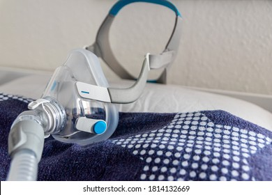 CPAP mask against obstructive sleep apnea on pillow helps patients as respirator mask and headgear clip for breathing medication with a cpap machine against snoring and sleep disorder to breath easier