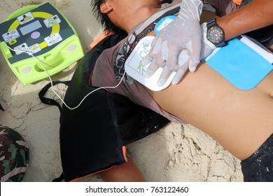 CPR and AED on the beach ,Training Automated External Defibrillator for Rescue and first aid in Thailand.