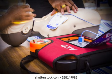 cpr with aed training select focus AED text and blur background