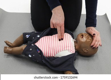 Cpr demonstration on an infant manikin