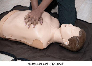 CPR first aid training with hand on full body cpr trauma mannequin