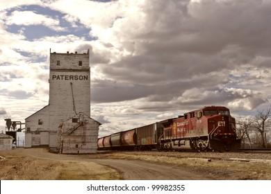 CPR grain train passing by old Parkbeg grain elevator