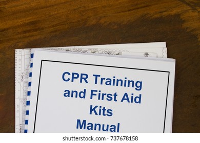 CPR Training and First Aid Kits manual concept with cover page of a book.