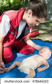 CPR training procedure with an infant dummy doll