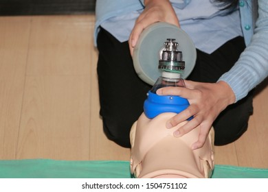 CPR training using and an AED and bag mask valve on an adult training manikin.Healthcare Concept