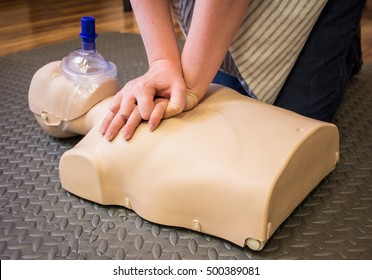 CPR training using a breathing mask on an adult training manikin
