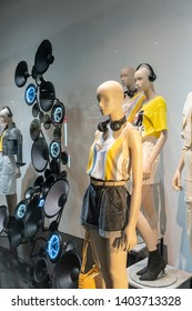 CPS shop at Siam Paragon, Bangkok, Thailand, Apr 25, 2019 : Fashionable brand window display. Standing models in different styles of colorful clothings.
