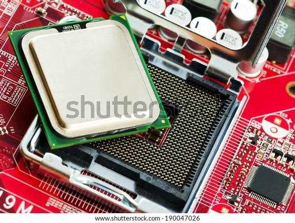 CPU socket and proccesor close up image.