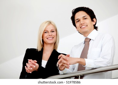 Cpuple of business people smiling in an office
