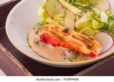 The crab baked with mushrooms fricassee and cream of a loster is served with a garden radish and greens