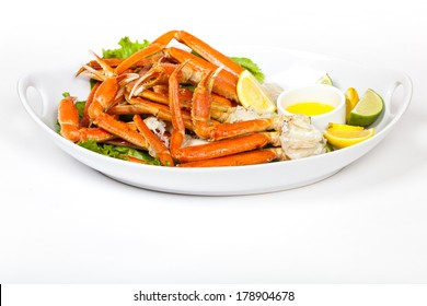 Crab Legs with fresh lemon slices and butter sauce