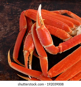 Crab legs on brown background